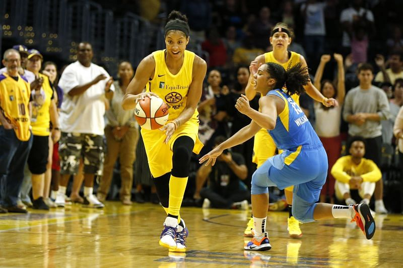 Candace Parker #3 of the Los Angeles Sparks drives around forward Gabby Williams #15 of the Chicago Sky