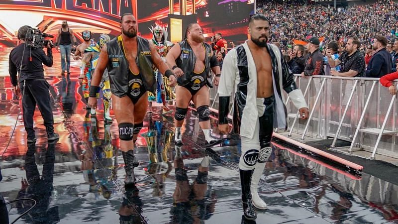 Andrade with several other stars at WrestleMania 35