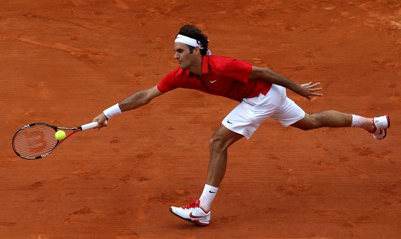 Roger Federer retrieves a ball at the 2011 French Open