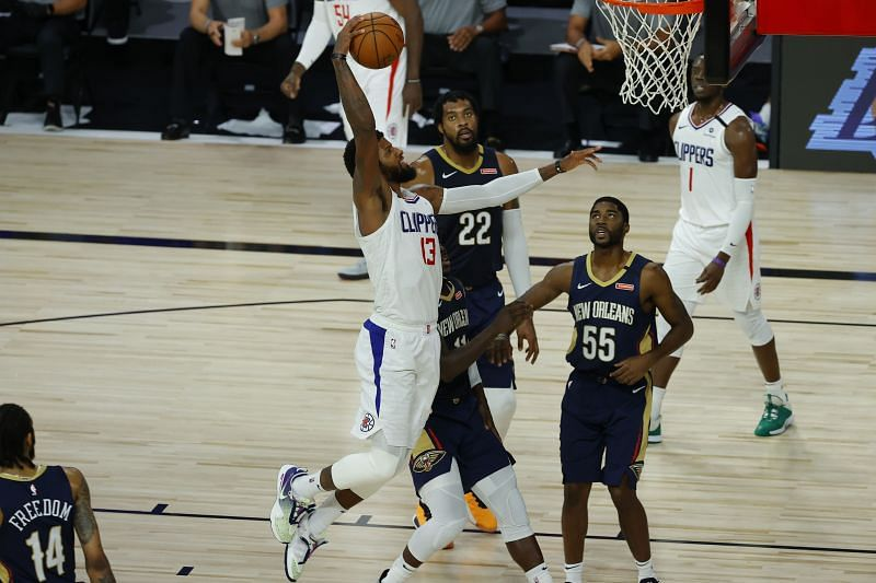 Paul George (#13) of the LA Clippers rises for a dunk against the New Orleans Pelicans.