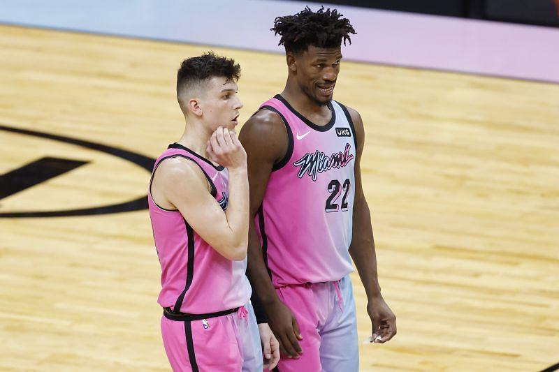 Tyler Herro (#14) and Jimmy Butler (#22) of the Miami Heat