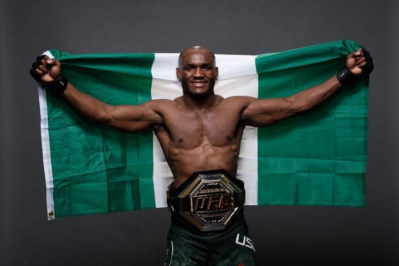 #2 UFC P4P fighter Kamaru Usman with the Nigerian flag and UFC welterweight belt.
