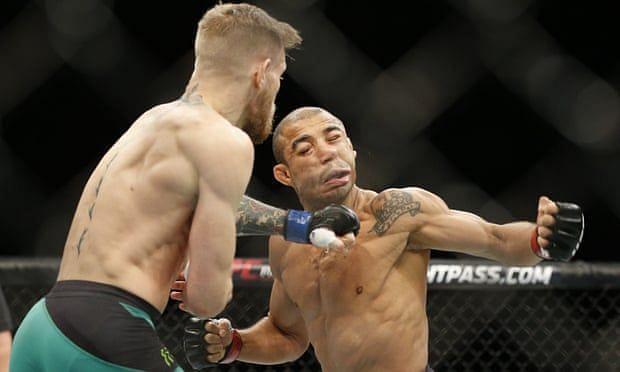 Conor McGregor knocks out Jose Aldo (Photo Credit: JOHN LOCHER / AP)