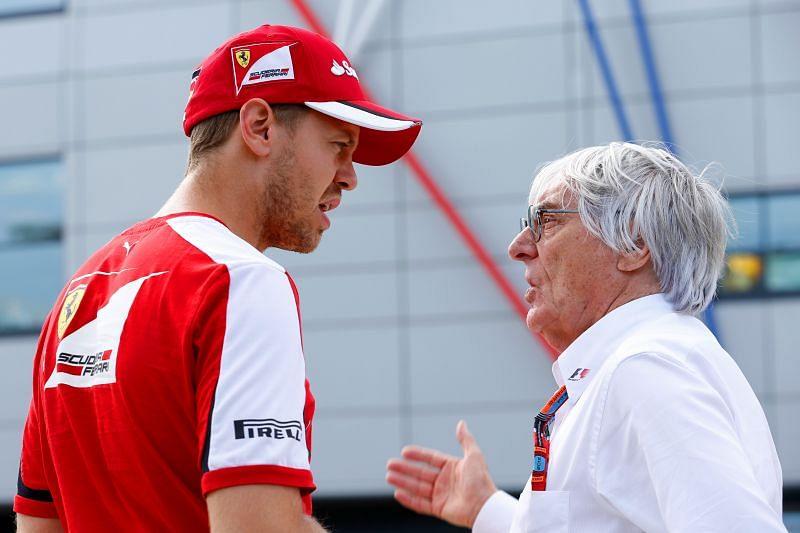 Sebastian Vettel (L) speaks with Bernie Ecclestone (R). Photo: Charles Coates/Getty Images.
