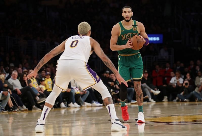 Jayson Tatum #0 looks to pass the ball during the game