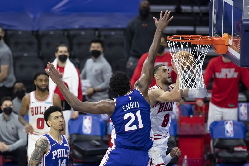 Zach LaVine #8 of the Chicago Bulls shoots the ball against Joel Embiid #21 of the Philadelphia 76ers