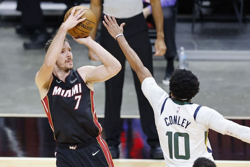 Goran Dragic #7 shoots over Mike Conley #10. Jimmy Butler #22 drives to the basket against Alec Burks #18