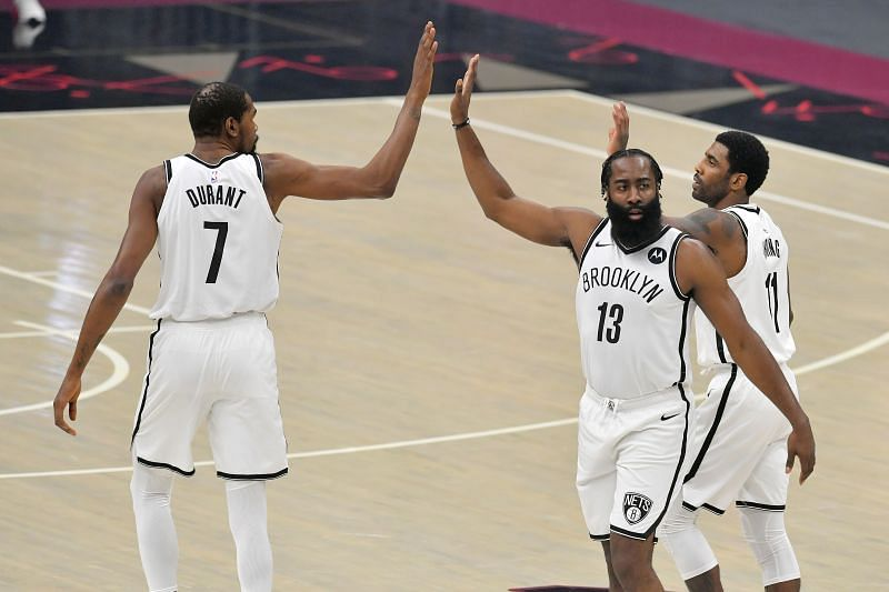 Kevin Durant (#7), James Harden (#13) and Kyrie Irving #11 of the Brooklyn Nets