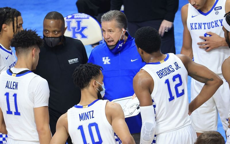 John Calipari gives instructions to his team