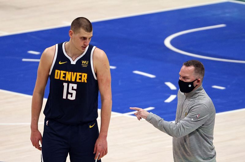Head coach Mike Malone and Nikola Jokic #15 of the Denver Nuggets