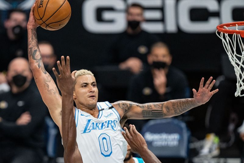 Kyle Kuzma #0 about to dunk the ball