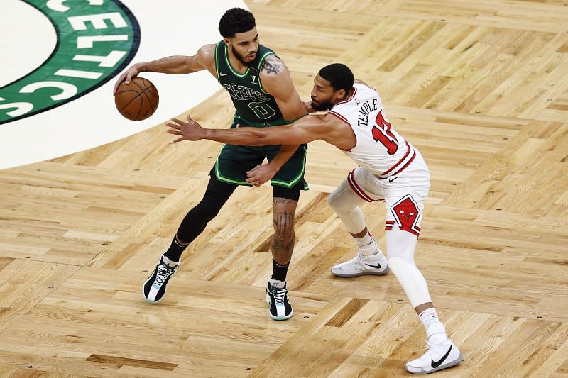 Garrett Temple #17 of the Chicago Bulls defends Jayson Tatum #0 of the Boston Celtics