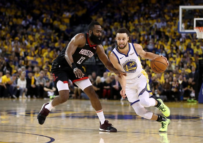 Steph Curry (#30) drives the ball past James Harden.