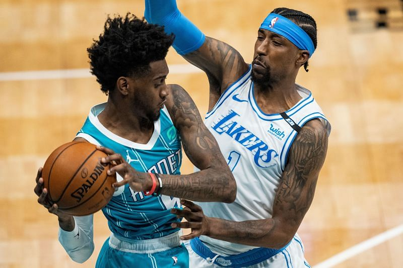 Jalen McDaniels #6 is guarded by Kentavious Caldwell-Pope #1