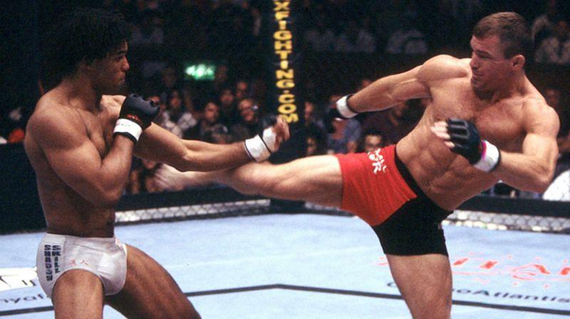 Matt Hughes (right) kicks Carlos Newton (left)