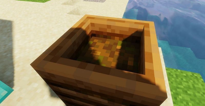 Shown: A player creating Bonemeal in a compost bin (Image via Minecraft)