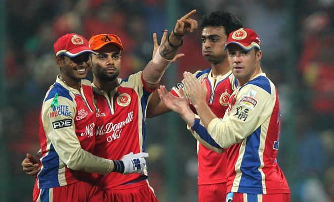 RCB players celebrate a wicket during the encounter against Delhi (Source: PTI)