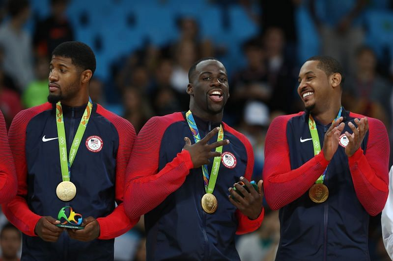 (Left to right) Paul George , Draymond Green and Carmelo Anthony stand on the podium with gold medals