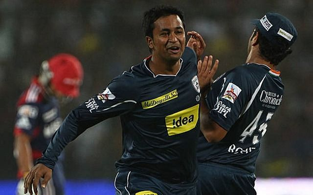 Pragyan Ojha celebrates a wicket with Rohit Sharma in IPL 2010.