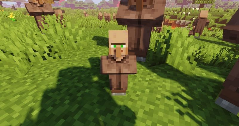 A baby villager spotted within a large crowd of Villagers (Image via Minecraft)