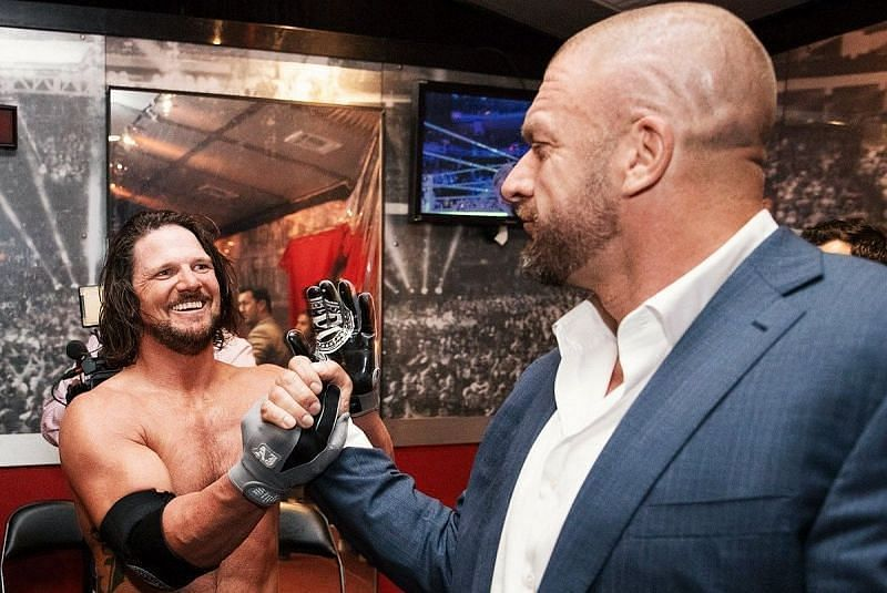 AJ Styles and Triple H backstage