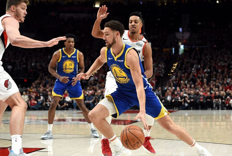 Klay Thompson #11 drives to the basket.