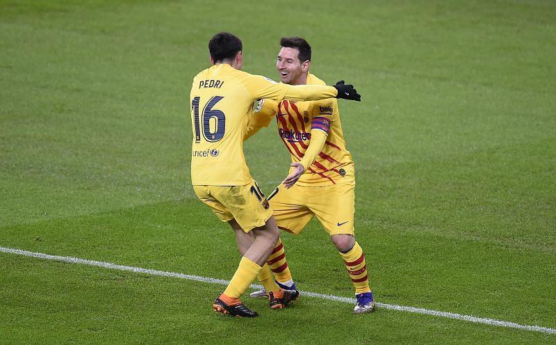 Lionel Messi celebrating with Pedri