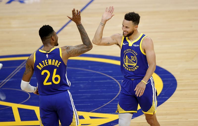 Stephen Curry #30 and Kent Bazemore #26 of the Golden State Warriors congratulate one another.