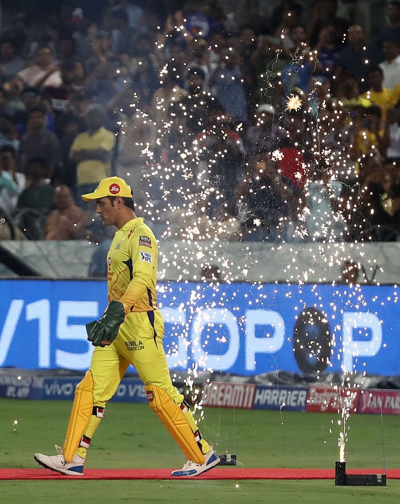 MS Dhoni walks on to the field leading the Chennai Super Kings.