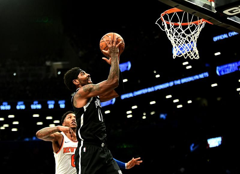 Elfrid Payton #6 watches as Kyrie Irving #11 takes a shot