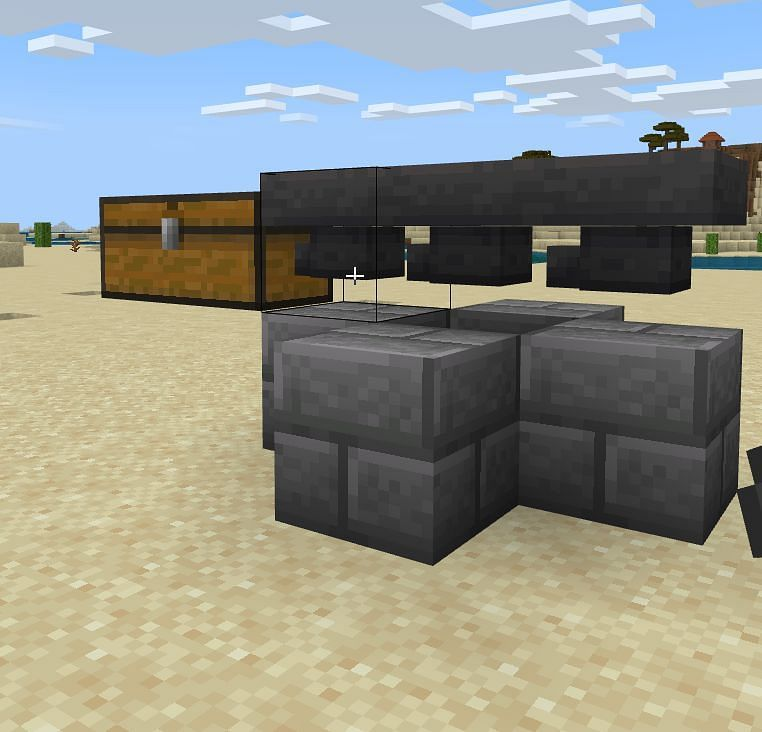 Next you will want to place three hoppers over the center of your construction and two sets of diamond ore one block away from the side that the chest is on.