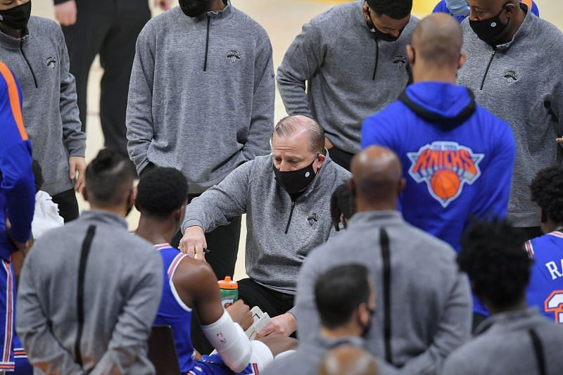 New York Knicks head coach Tom Thibodeau huddles with his players during a timeout