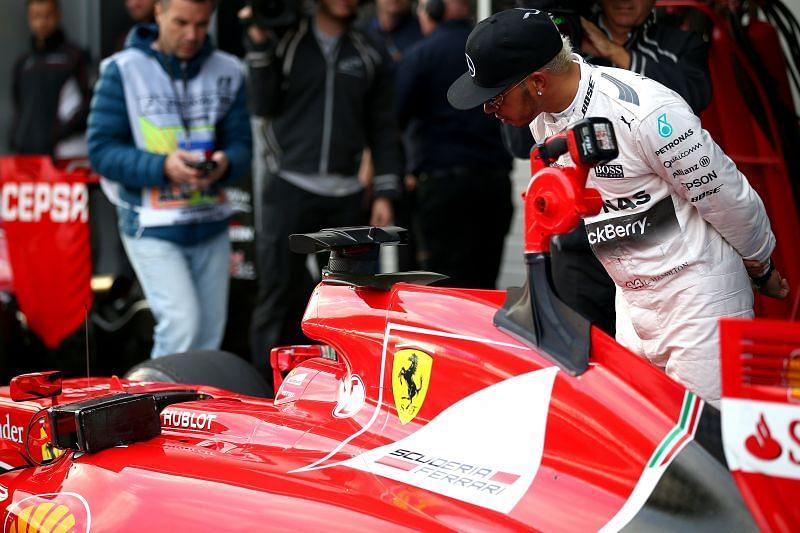Lewis Hamilton looks at Sebastian Vettel
