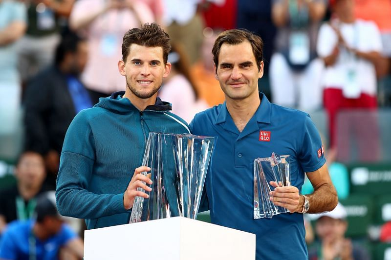 Dominic Thiem (L) and Roger Federer pose at the 2019 Indian Wells Masters trophy ceremony
