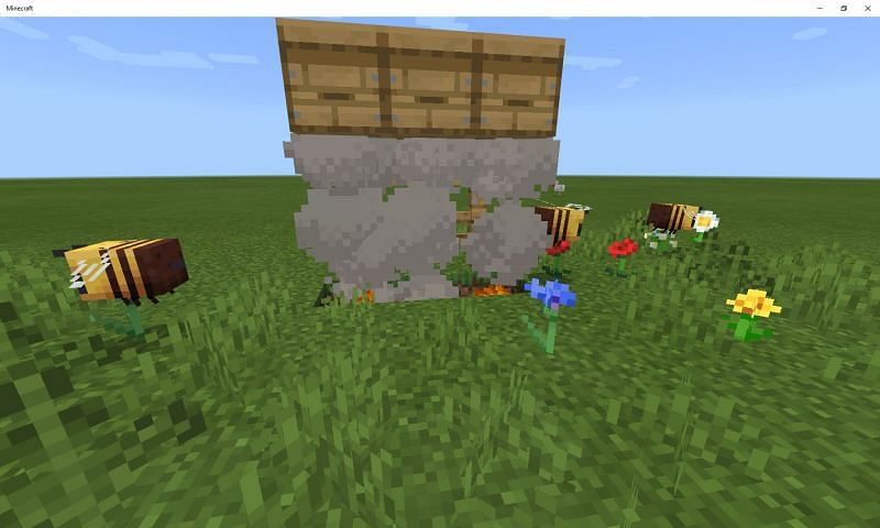 Minecraft bees collecting pollen (Image via Mojang)