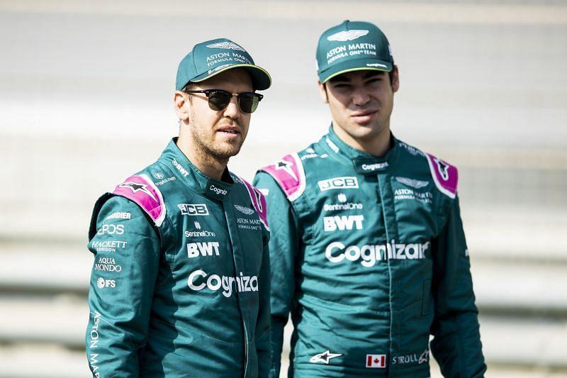 Sebastian Vettel and Lance Stroll of Aston Martin F1 Team look on. Photo: Mark Thompson/Getty Images.