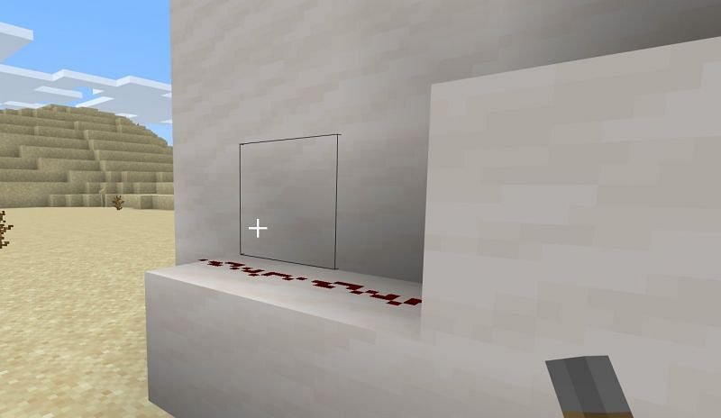 Once you have taken note of where you placed your lever, place a block right under the spot of where the lever would be on the outside of your house and then connect it with a trail of Redstone dust