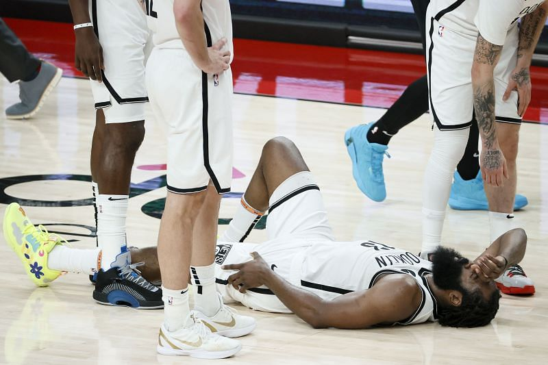 James Harden #13 reacts after falling on the floor.