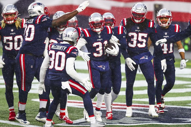 The New England Patriots celebrate against the New York Jets on Jan. 3, 2021.