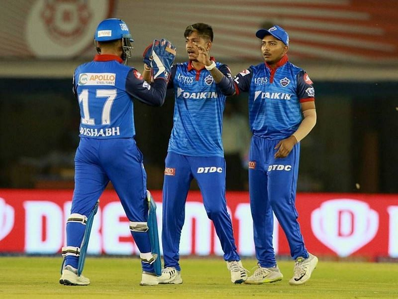 Sandeep Lamichhane (center) celebrating the wicket of Punjab