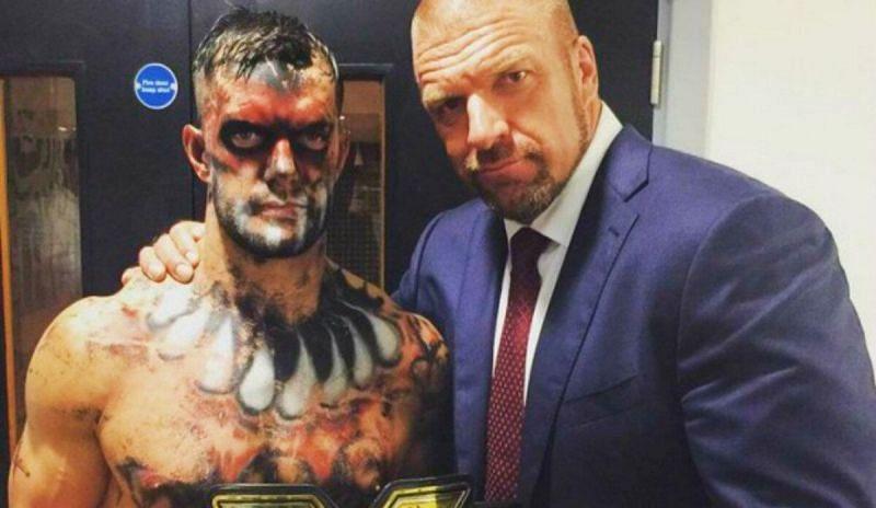 Triple H backstage with Finn Balor