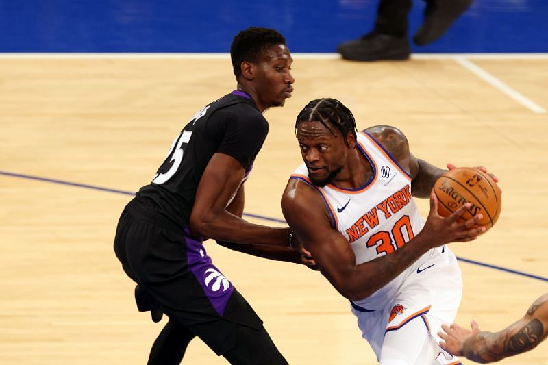 Julius Randle (#30) of the New York Knicks drives to the basket as Chris Boucher (#25) of the Toronto Raptors defends