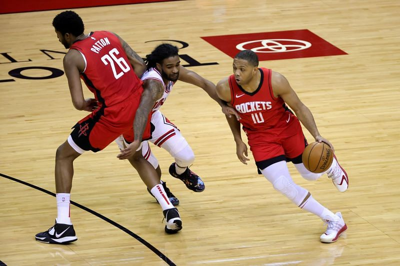 Justin Patton #26 sets a pick on Coby White #0 for Eric Gordon #10