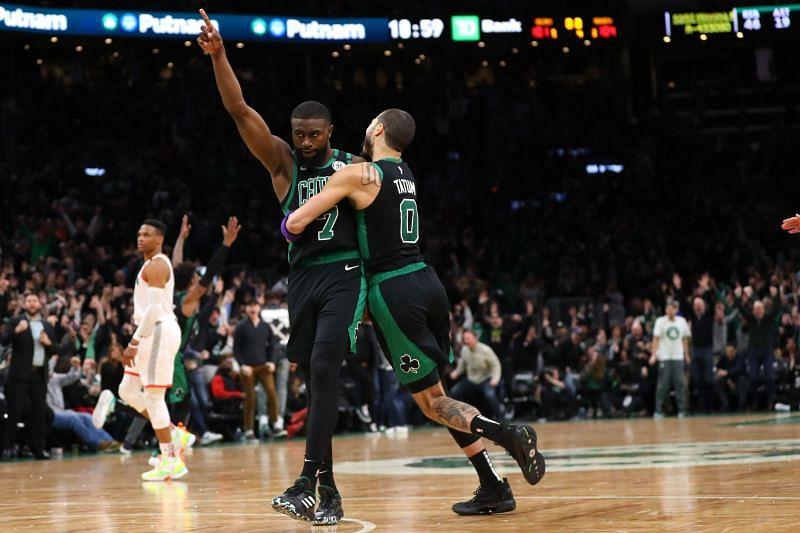 Jaylen Brown #7 of the Boston Celtics celebrates with Jayson Tatum #0