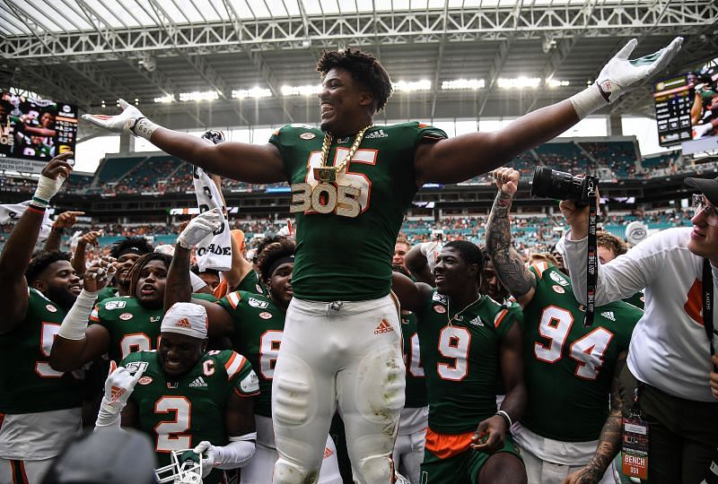 """Miami edge rusher Gregory Rousseau celebrates with the """"Turnover Chain"""" after a sack and fumble recovery against Central Michigan on Sept. 21, 2019, in Miami, Florida"""