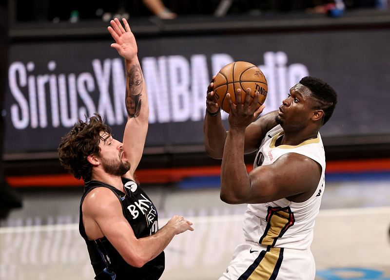 Zion Williamson #1 heads for the net as Joe Harris #12 defends