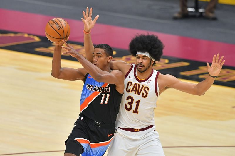 Theo Maledon #11 passes while being guarded by Jarrett Allen #31.
