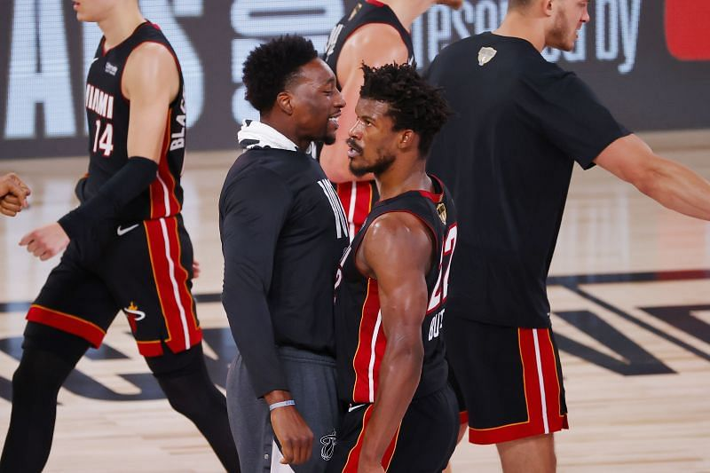 Jimmy Butler #22 of the Miami Heat reacts with Bam Adebayo #13
