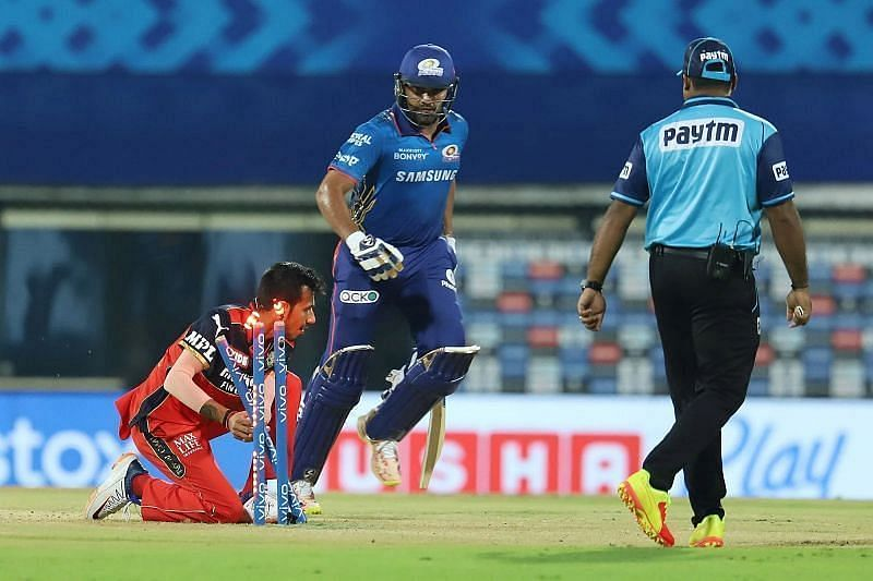 Rohit Sharma was run out after a mix-up with Chris Lynn.