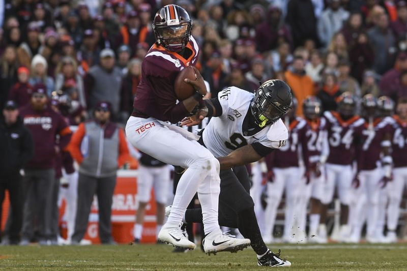 Wake Forest defensive end Carlos Basham Jr. reaches to tackle Virginia Tech quarterback Hendon Hooker on Nov. 9, 2019.